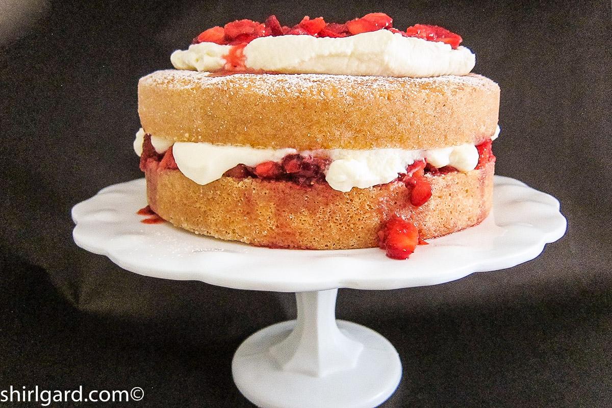 Creamy White Strawberry Shortcake on Cake Stand