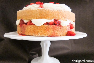 Creamy White Strawberry Shortcake on Cake Stand